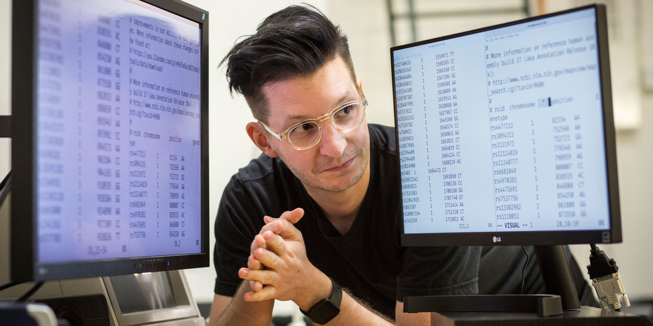 MNT's Lukas F. Hartmann staring at his sequenced DNA, Photo by TAZ